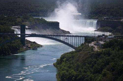 The Rainbow Bridge is seen crossing from the US (L) into Canada, near the Niagara Falls, on June 4, 2013