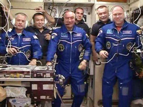 This still image from NASA TV shows Expedition 39, now a six-member crew, talking to family and mission officials moments after