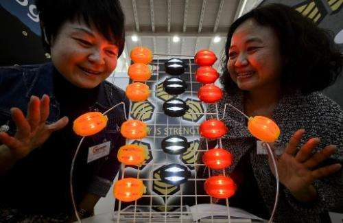 Two Taiwanese exhibitors present their creation during the opening day of the International Exhibition of Inventions of Geneva,