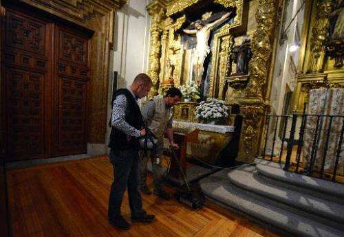 Two technicians sweep a ground-penetrating radar across the Convent of Trinitarians in central Madrid, on April 28, 2014, as the