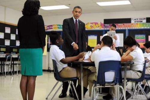 US President Barack Obama (C) visits a classroom at Buck Lodge Middle School in Adelphi, Maryland, on February 4, 2014