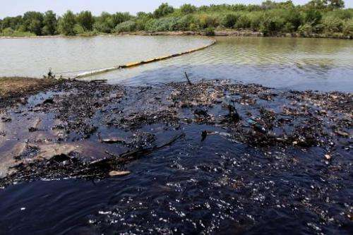 View of the San Juan river after an oil spill, in San Juan Cadereyta, Mexico, on August 21, 2014