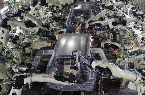View shows the body welding workshop which uses automated welding machine robots at Toyota Motor's Tsutsumi plant in Japan on De