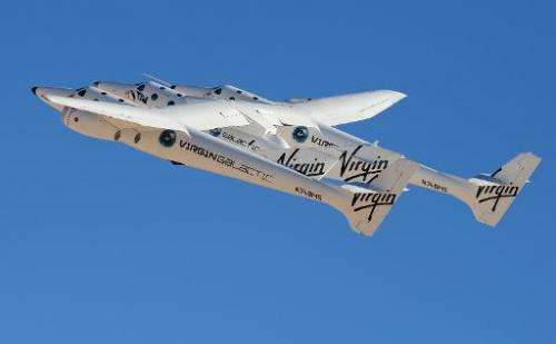Virgin Galactic's WhiteKnightTwo, carrying SpaceShipTwo, takes flight in New Mexico, on October 17, 2011
