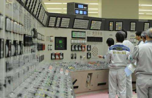 Workers make preparations inside the control room to restart the Monju Prototype Fast Breeder Reactor, in Tsuruga, Fukui prefect