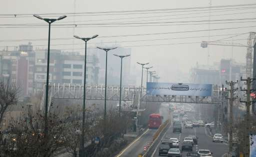 The heavily polluted skyline of Tehran pictured from the west of Iranian capital on December 14, 2015