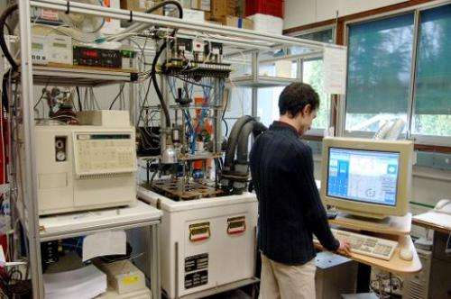 File photo of a researcher analysing samples at the Laboratory for Glaciology and the Geophysics of the Environment, in Grenoble