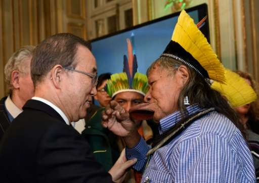 UN Secretary General Ban Ki-moon speaks with Brazilian indigenous rights activist and chief of the Kayapo Amazonian Indian tribe