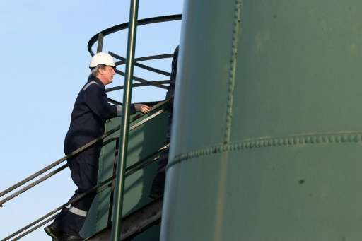 British Prime Minister David Cameron participates in a guided tour of the IGas shale drilling plant oil depot near Gainsborough,