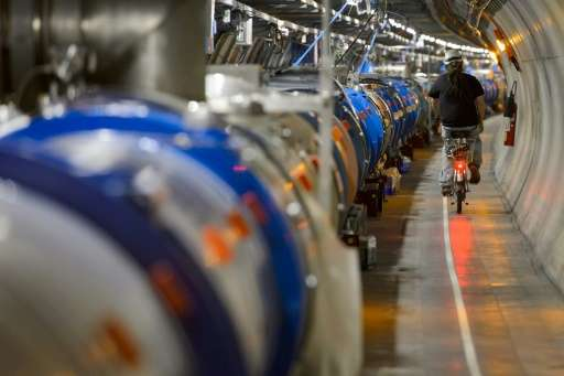 A worker rides his bicycle in a tunnel alongside the European Organisation for Nuclear Research (CERN) Large Hadron Collider (LH