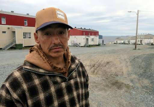Lucassie Cookie, a local, poses for a photograph in the Inuit village of Umiujaq, in Nunavik territory, Hudson Bay, Quebec