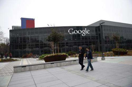 People walk on the Google campus in Mountain View, California, on February 20, 2015