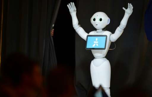 'Pepper' the humanoid robot communicates with the audience during a demonstration at WSJDLive technology conference in Laguna Be