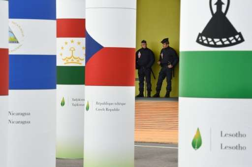 Police officers stand guard at the entrance of the COP21 United Nations Conference on climate change, at Le Bourget, northeaster