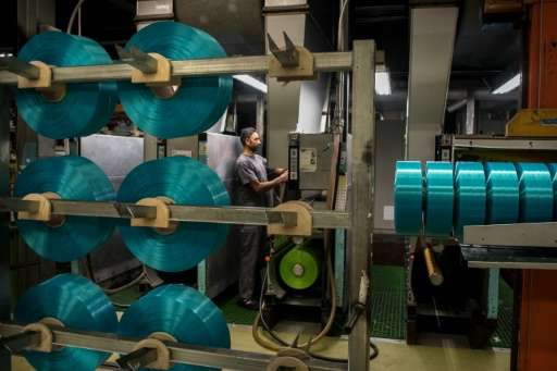 Spools of yarn made from plastic waste at a processing plant in Angles, northeastern Spain