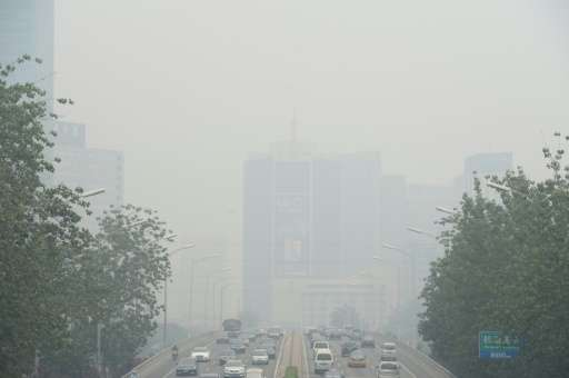 Vehicles on smog-blighted streets in Beijing on June 23, 2015