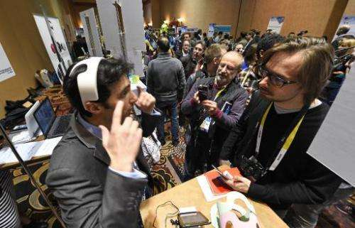Yohan Attal of myBrain Technologies wears the Melomind headset at CES Unveiled, the opening event for the media preview days at