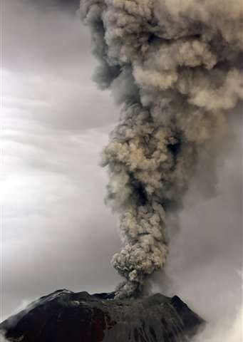 Ecuador volcano sends up towering cloud of ash