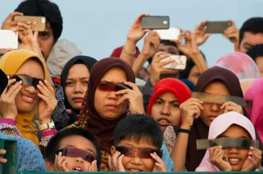 People watch the total solar eclipse in Banda Aceh on March 9, 2016
