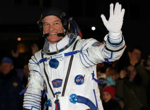 US astronaut Jeff Williams waves at the Russian-leased Baikonur cosmodrome in Kazakhstan, prior to blasting off to the Internati