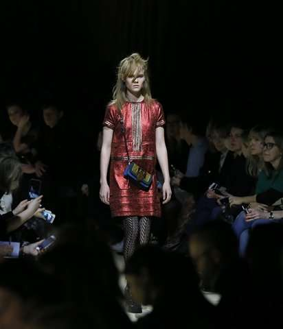 Luxury fashion world upending tradition to join digital age