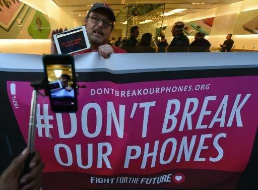 Protesters demonstrate outside an Apple Store as they object to the US Government's attempt to put a backdoor to hack into the A