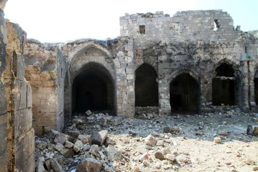 A picture taken on March 21, 2014, shows the damage in the renowned Crusader castle Krak des Chevaliers near the Syria-Lebanon b