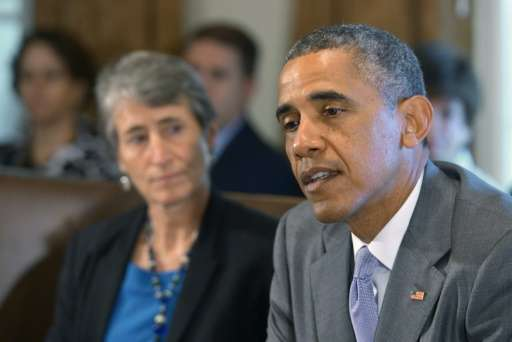 US President Barack Obama speaks during a cabinet meeting next to Secretary of the Interior Sally Jewell at the White House in J