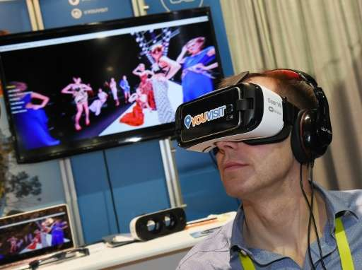 A delegate uses a virtual reality headset during a visit to the YouVisit booth at the Consumer Electronics Show in Las Vegas, on