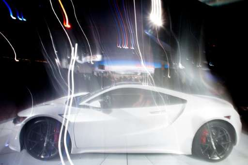 An Acura NSX is photographed with a long exposure as it rotates on a turntable at the 2016 North American International Auto Sho