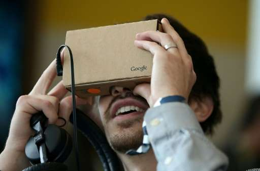 An attendee inspects Google Cardboard during the 2015 Google I/O conference in San Francisco, California