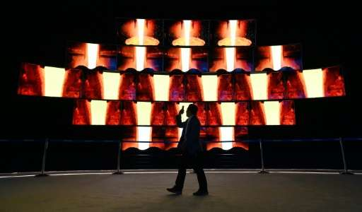 An attendee walks by a video display at the Samsung booth at CES 2016 on January 6, 2016 in Las Vegas, Nevada