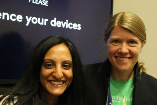Archeologist Sarah Parcak, pictured with TED Prize director Anna Verghese (L), wants people around the world to become explorers