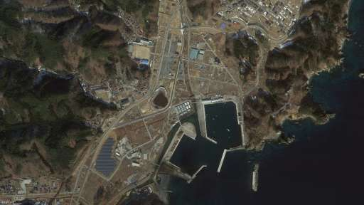 "A satellite image from Google's ""East Japan Earthquake digital archive project"" shows the Japanese city of Miyako, in"