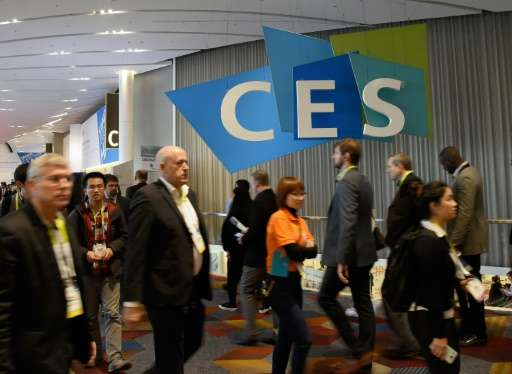 Attendees walk past a CES logo at CES 2016 at the Sands Expo and Convention Center on January 6, 2016 in Las Vegas, Nevada
