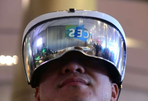 Attendee Wei Rongjie wears a working prototype of his HoloSeer AR/VR all-in-one agumented reality and virtual reality headseat o