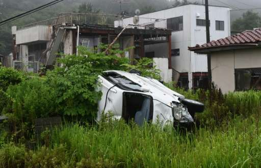 A vehicle and houses damaged by the 2011 tsunami lie untouched after four years, in the village of Tomioka, in Fukushima prefect