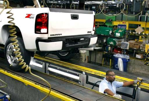 A worker assembles General Motors trucks at the GM Flint Assembly Plant July 18, 2011 in Flint, Michigan