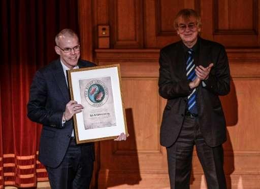 Bill McKibben (L) representing the grassroots organisation 350.org (USA) receives the Right Livelihood Award from Jakob von Uexk