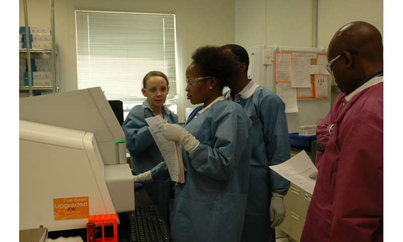 Los Alamos's Cheryl Gleaner (left) demonstrates to students how to use EDGE bioinformatics to analyze their sequence data. At its annual Sequencing and Bioinformatics Training in June, Los Alamos hosted 34 participants from ten countries to train them in sequencing and analysis, including the use of EDGE bioinformatics. EDGE tools are currently in use in eight countries as well as within several government laboratories in the United States.
