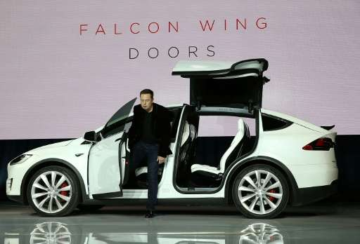 Elon Musk demonstrates the falcon wing doors on the Tesla Model X Crossover SUV on September 29, 2015 in Fremont, California
