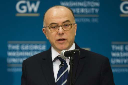 French Interior Minister Bernard Cazeneuve speaks at George Washington University in Washington, DC, March 11, 2016, during a di