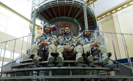 (From L) US astronaut Jeff Williams, Russian cosmonauts Alexey Ovchinin and Oleg Skripochka will be joining NASA astronaut Tim K