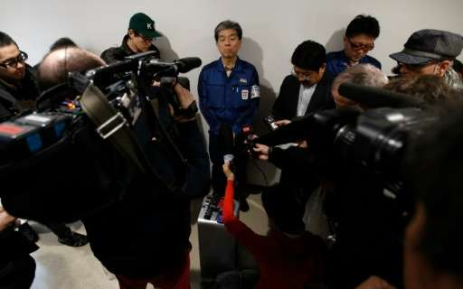 Fukushima chief Akira Ono (centre) speaks to reporters during a media tour of TEPCO's tsunami-crippled nuclear power plant in Ok