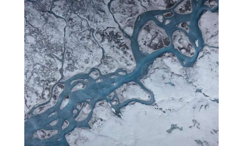 Greenland's ice is getting darker, increasing risk of melting