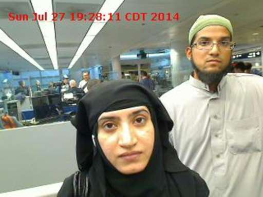 Image obtained from US Customs and Border Protection December 7, 2015 shows Syed Farook (R) and Tashfeen Malik as they went thro