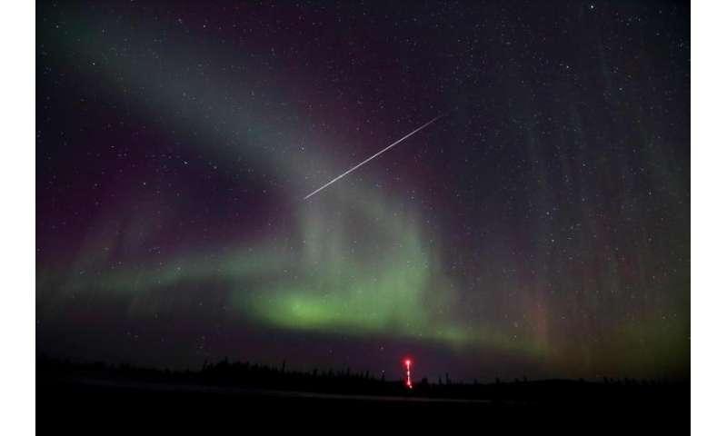 Image: Taurid meteor captured against Northern lights