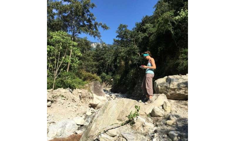 Marin Clark assessing boulders deposited during a monsoon-triggered debris flow near Timbu, Nepal. Credit: Dimitrios Zekkos