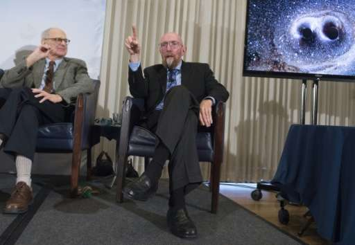 LIGO co-founders Kip Thorne (R), and Rainer Weiss (L), speak about gravitational waves during a press conference at the National