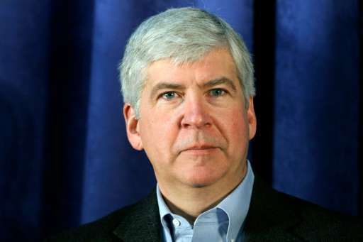 Michigan Governor Rick Snyder attends a press conference at the General Motors Flint Assembly Plant on January 24, 2011 in Flint